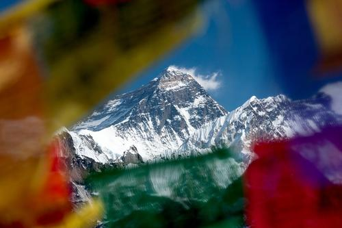 colourful flags around Everest